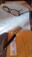 caneta oculos carta e iberê
